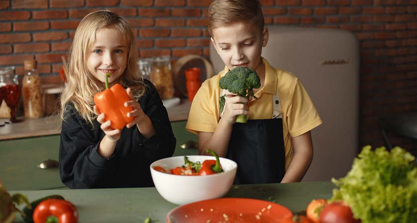Children enjoying veggies. Photo by Gustavo Fring from Pexels.