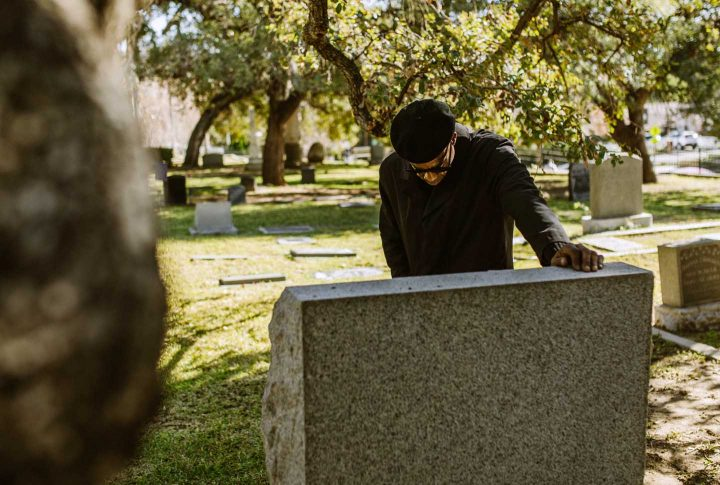 Mourning on the grave of a loved one - Photo by RODNAE Productions from Pexels
