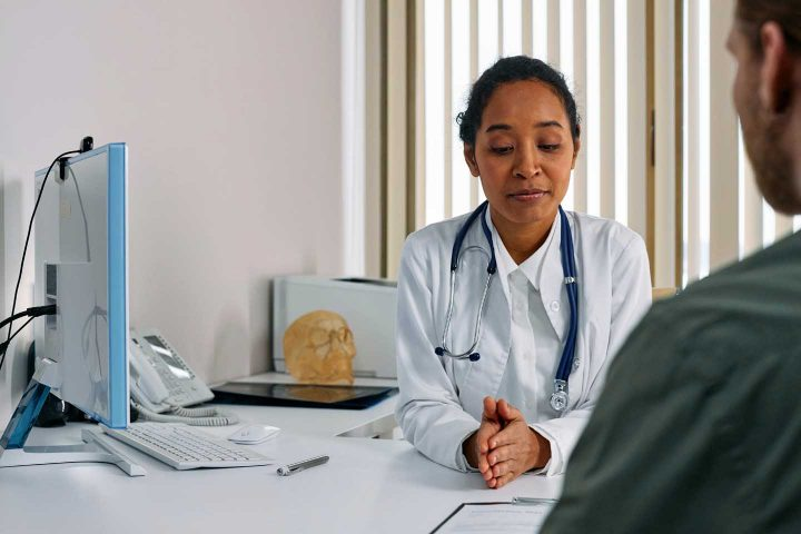 A doctor consulting a patient - Photo by cottonbro from Pexels