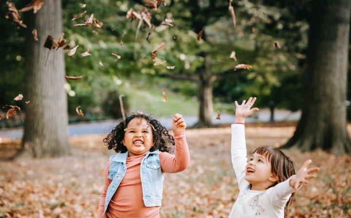 Children playing outside with leaves - Photo by Charles Parker from Pexels